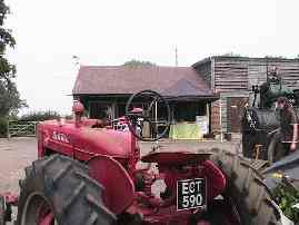 A Farmall tractor, facing the cafe and shop