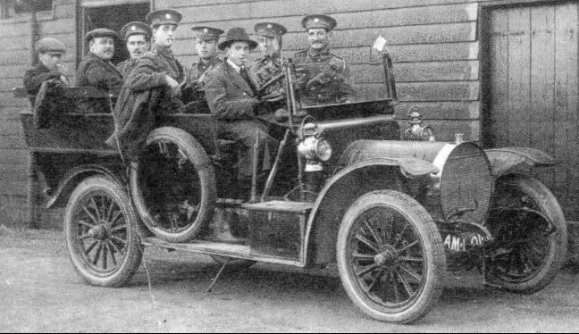 The Taxi  from  Bentley's Garage taking staff for an evening in Wokingham; the building in the background is the Quartermasters Stores